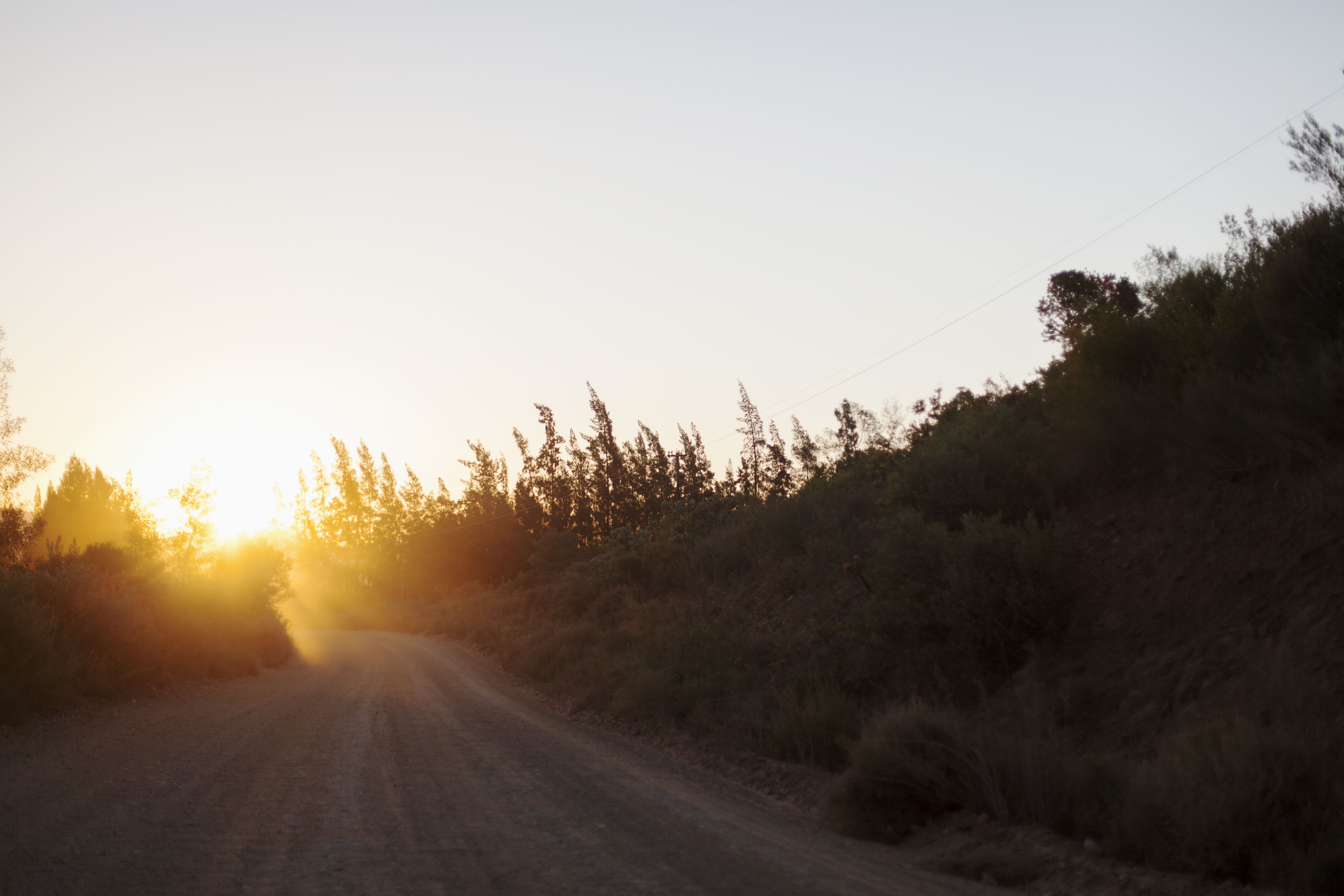 Gravel road in country with sunset